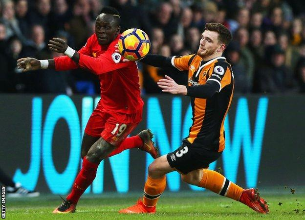 Andy Robertson in action for Hull, chasing Sadio Mane