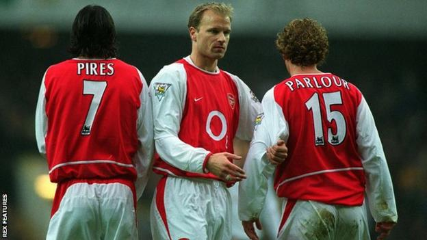 Robert Pires, Dennis Bergkamp and Ray Parlour line up to form a wall during a match for Arsenal