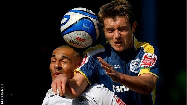Darren Pratley is beaten in the air by Stephen McPhail