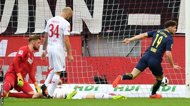 Oliver Burke celebrates scoring for RB Leipzig against Cologne