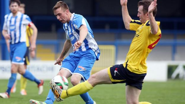 Bannsiders forward Ian Parkhill is tackled by Dungannon's Dermot McCaffrey at the Showgrounds