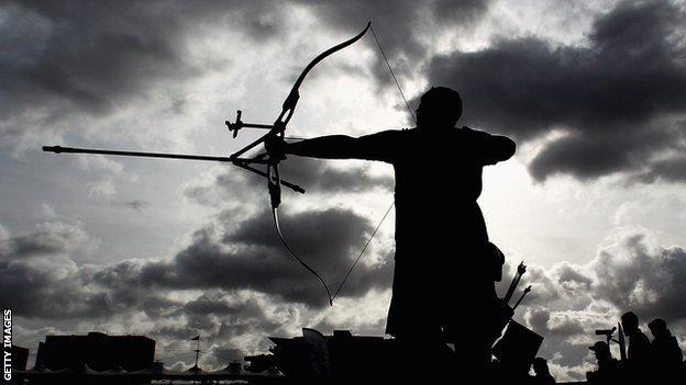 An archer gets ready to fire an arrow
