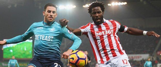 Wilfried Bony challenges Swansea City's Angel Rangel