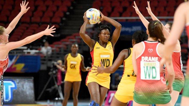 Suzy Drane marshalls the Wales defence to repel another Uganda attack