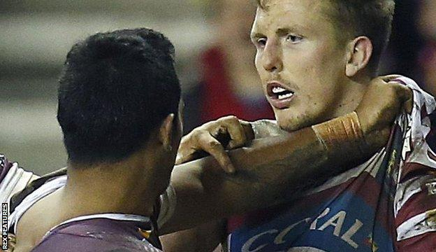Wigan's Dan Sarginson and Brisbane's Joe Ofahengaue tussle in 2015