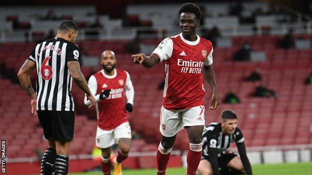 Bukayo Saka celebrates after scoring against Newcastle