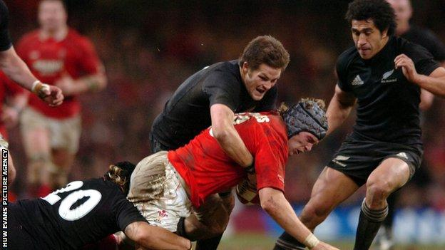 New Zealand captain Richie McCaw tackles Alun Wyn Jones in November 2006
