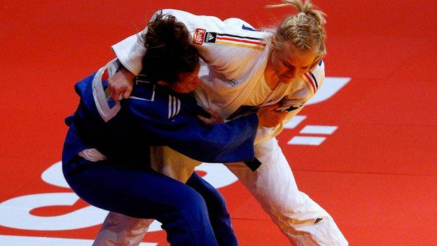 Britain's Natalie Powell in action (in blue)