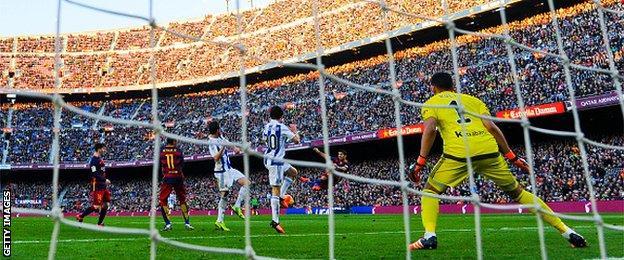 Barcelona forward Luis Suarez scores against Real Sociedad