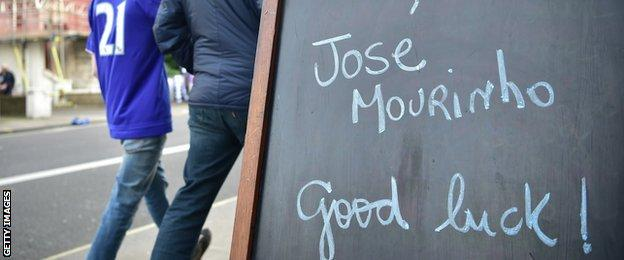 A cafe sign wishes Jose Mourinho good luck outside Stamford Bridge