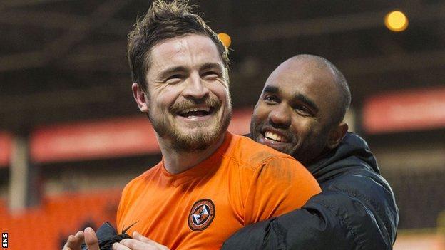 Dundee United's Paul Paton celebrates with Florent Sinama-Pongolle