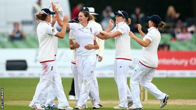 Kate Cross and England team-mates celebrate a wicket against Australia.