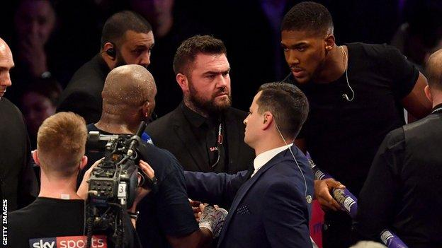 Joshua and Whyte - who fought in 2015 - exchanged words over the ring ropes in London