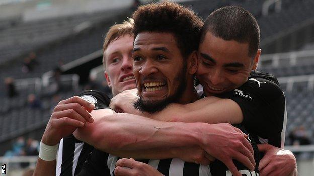 Joelinton celebrates after his goal for Newcastle against Tottenham