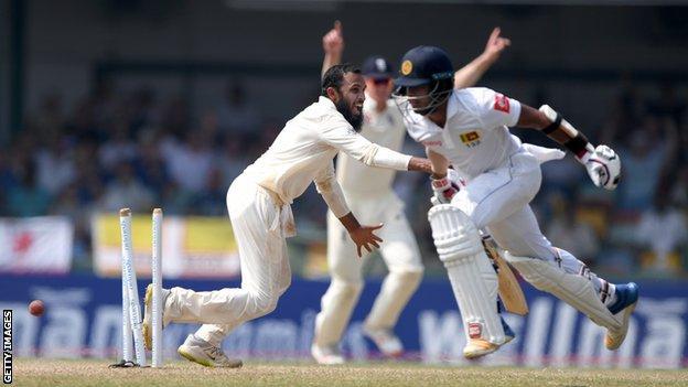 England spinner Adil Rashid celebrates as Sri Lanka batsman Kusal Mendis is run out by Jack Leach (not pictured)