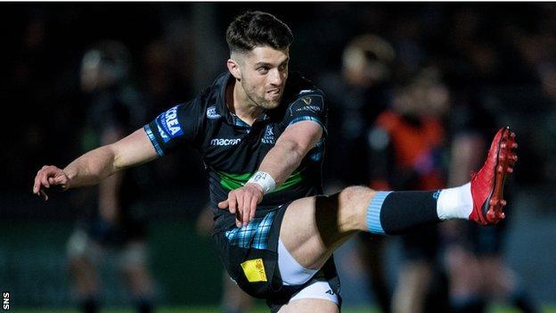 Adam Hastings slots a kick for Glasgow