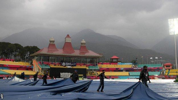 Groundstaff at Dharamsala pull on covers