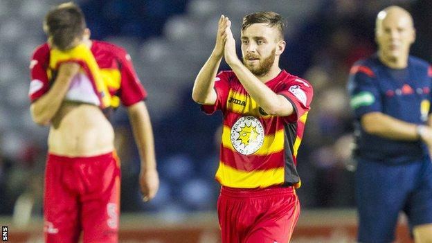 Partick Thistle's Steven Lawless applauds the fans after the game