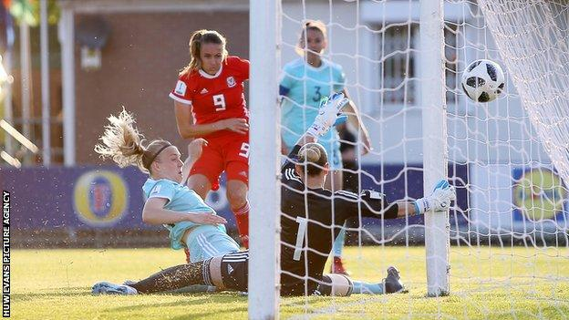 Kayleigh Green of Wales scores a goal