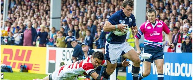 John Hardie carries the ball for Scotland against Japan