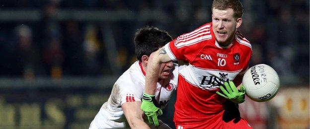 Tyrone's Mattie Donnelly manages to get the ball out of Enda Lynn's grasp in Saturday night's decider