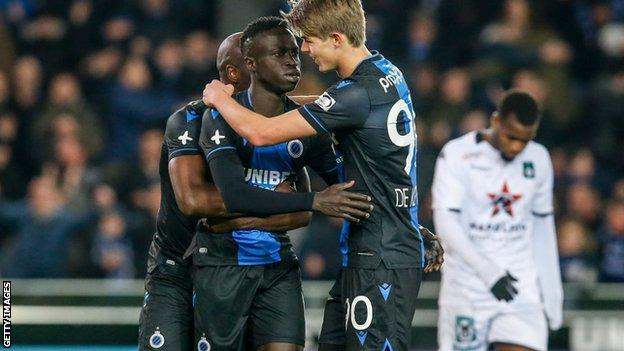 Club Bruges players celebrate scoring a goal against Cercle Bruges on 7 March