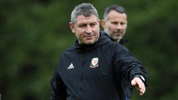 Osian Roberts with Wales manager Ryan Giggs in the background