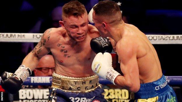 Warrington retained his IBF featherweight world title with an emphatic win over Frampton in Manchester
