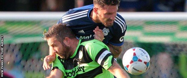 Sean Morrison in action against former Bluebird Jon Parkin
