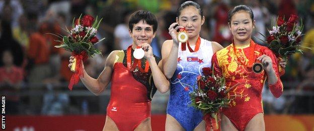 Chusovitina poses with the other medalists at the 2008 Olympics