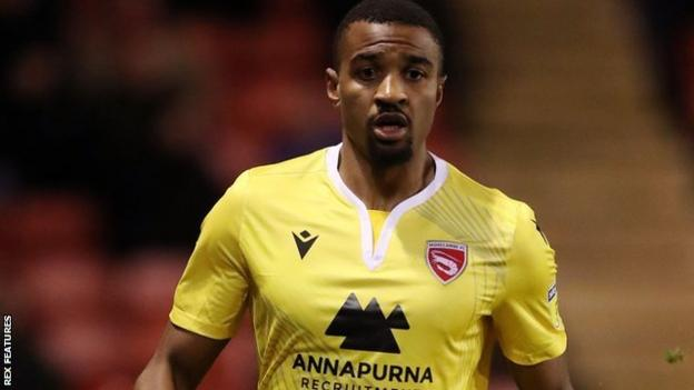 Christian Mbulu in action for Morecambe at Walsall in League Two in January 20202