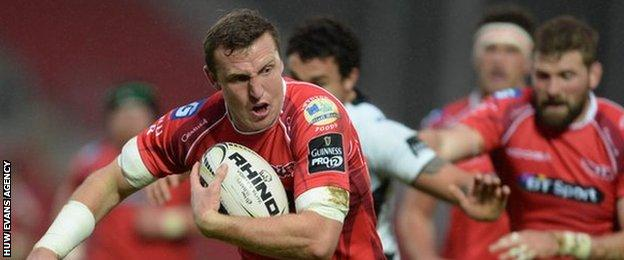 Hadleigh Parkes breaks clear to score Scarlets' opening try against Zebre