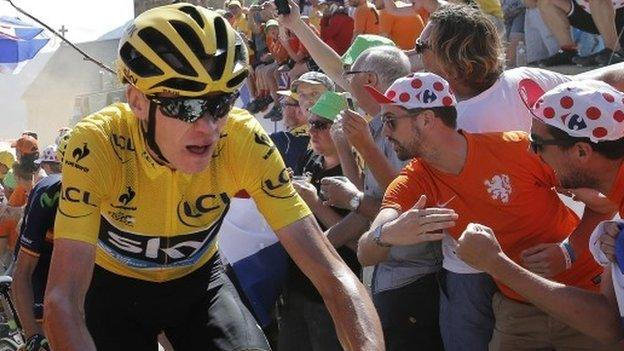 Chris Froome rides up Alpe d'Huez