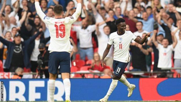 Bukayo Saka celebrates scoring for England against Andorra in a World Cup qualifying match