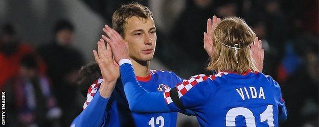 Marko Leskovic (left) celebrates with Croatia