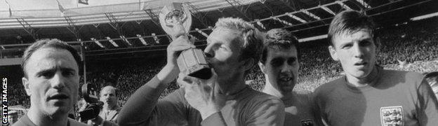 Bobby Moore kisses the World Cup after England's 1966 win