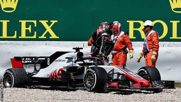 Romain Grosjean of Haas climbs out of his car after spinning during practice