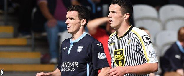 Paul McGinn (left) in action for Dundee against his brother John while he was playing for St Mirren