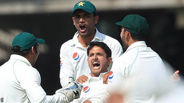 Mohammad Abbas celebrates taking the wicket of England's Joe Root