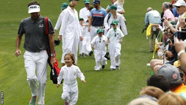 Bubba Watson running with his daughter