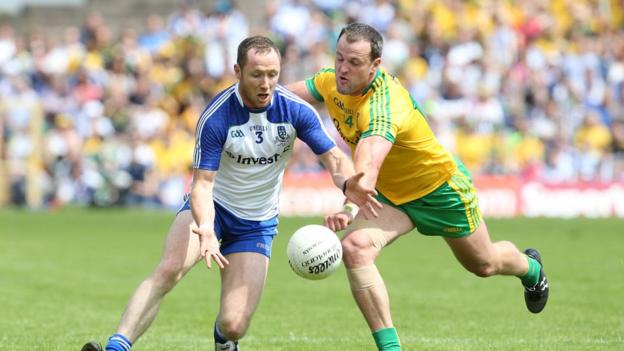Vinny Corey and Michael Murphy challenge for possession in the third consecutive provincial decider between their counties
