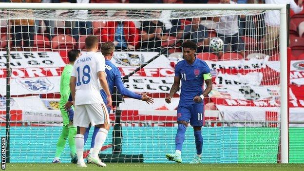 Marcus Rashford celebrates scoring for England against Romania