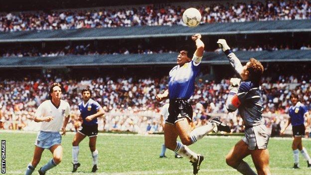 Diego Maradona scores against England using his hand