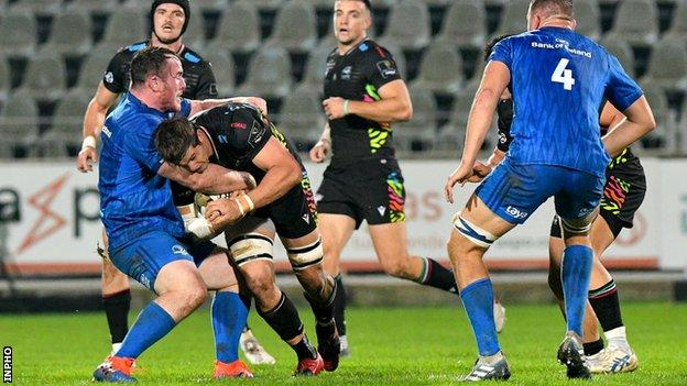 Leinster's Peter Dooley tackles Zebre's Johann Meyer