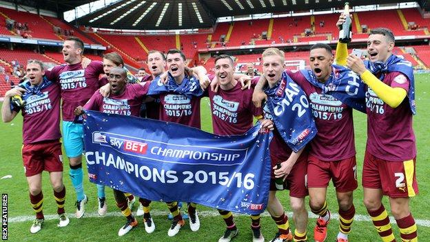 Burnley's players celebrate their Championship title