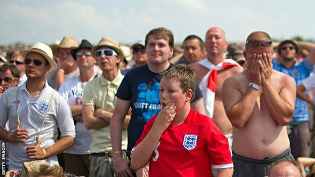 English football fans react as Germany score another goal against England on the final day of the Glastonbury festival
