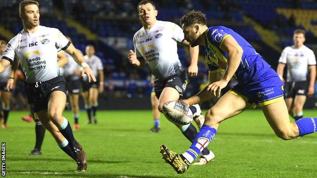 Toby King scores a try for Warrington