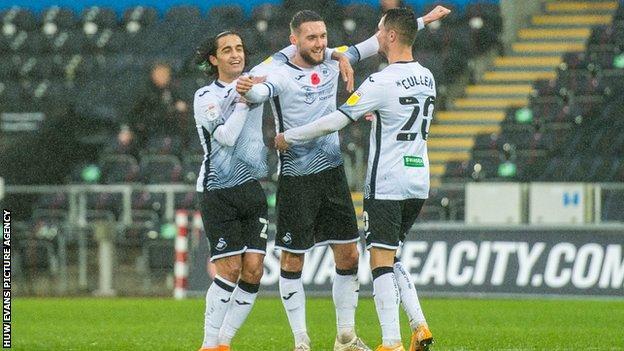 Swansea celebrate their opening goal