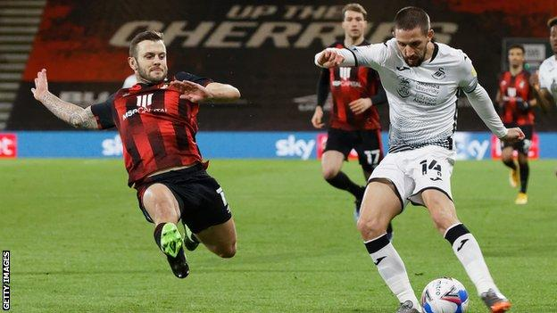 Bournemouth's Jack Wilshere stretches to block Swansea's Conor Hourihane