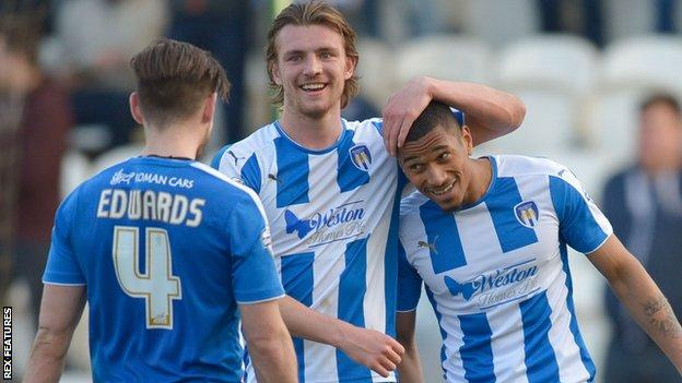 Colchester United's players celebrate